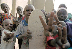 I wish peace to all my Flickr friends, Enjoy the holidays wherever you are (Mark William Brunner) Tags: africa travel west canon children hope peace desert angle mark muslim islam madras wide young peaceful mosque mali inspire brunner djenne koran texts afircan