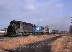 .CR 6148-6602-6564, JN-5, Manville, NJ.   12-07-1977 (jackdk) Tags: railroad train railway locomotive lehighvalley cr conrail manville sd45 emd erielackawanna penncentral c307 u33c jn5 manvillenewjersey emdsd45