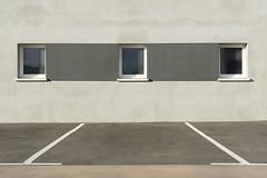 Parking and three windows (on Explore) (Jan van der Wolf) Tags: map158211ve parking parkeerplaats windows ramen lines lijnen lijnenspel symmetric symmetry symmetrie grey grijs monochrome monochroom wall muur