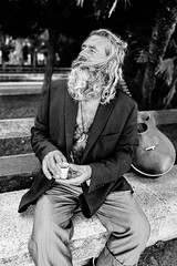 Street artist's smile (Giulio Magnifico) Tags: bw blackwhite soul smile guitar italy salerno happy singer beard streetartist streetlife strettphotography portrait 28mm leicaq leica