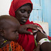 Fardowsa Abdullahi, 33 a mother of 8 children including twin daughters -Misra Nasir and Hinda Nasir, 11 months. Fardowsa is from a farming family affected by the drought