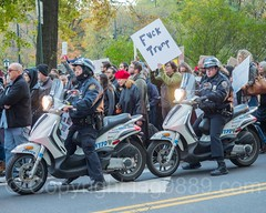 Anti-Trump Protesters march on Central Park South, New York City (jag9889) Tags: jag9889 president signboard demonstration manhattan banner rally people policeofficer 20161113 outdoor 2016 nypd centralparksouth immigrants donaldtrump 59thstreet scooter newyork elect text midtown immigration newyorkcity march latinos usa sign trump motorcycle protester cop finest firstresponder lawenforcement ny nyc newyorkcitypolicedepartment officer police policedepartment unitedstates unitedstatesofamerica us