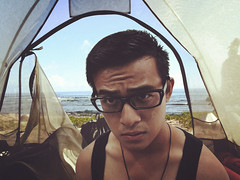 Oasis (ryandominiclim) Tags: asian guy male cool cute guys man men boy boys glasses bespectacled dog tag necklace hot sexy model handsome good looking singapore singaporean sg dude badass chinese serious candy tent outdoors adventure wake up woke tank top scenery vacation seaside view ocean sea oasis holiday trekking trek camp camping singlet outdoor