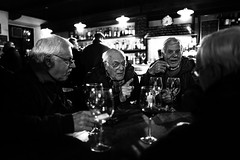 Friends in osteria (Giulio Magnifico) Tags: madeinitaly soulful streetphotography alcanarino wood friuli italy vintage happiness friends wine summilux 28mm blackwhite bw osteria street leica leicaq udine