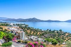 Schima, Crete (jack cousin) Tags: road travel pink sea summer sky holiday seascape flower building tree hotel bush nikon hill bluesky crete rails shrub peninsula d610 on1photos