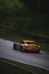 BMW Z4 (Garret Voight) Tags: motion blur sports car wisconsin racecar speed corner automobile track automotive racing bmw vehicle roadamerica autoracing z4 panning circuit motorsports motorracing imsa turnermotorsport elkhartlake tudorunitedsportscarchampionship