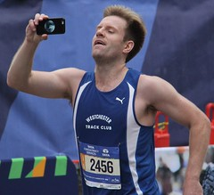 Selfie as he nears the finish line of the NYC Marathon (AndrewDallos) Tags: park new york city nyc manhattan marathon central runner selfie