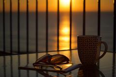 Morning Cuppa (jayneboo) Tags: barcelona light holiday sunglasses sunrise holidays break tea bokeh balcony mug sitges cuppa