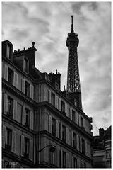 Au dessus de nous (MNP[FR]) Tags: city blackandwhite paris france building tower architecture clouds europe tour noiretblanc cloudy samsung eiffel nuage iledefrance ville nuageux nx1 baladesparisiennes