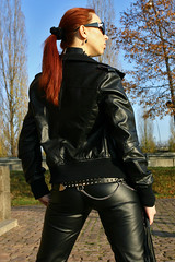 Cora 15 (The Booted Cat) Tags: red sexy girl leather hair model pants whip tight mistress dominatrix