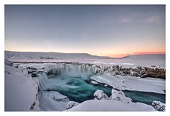 Goafoss (Chris Wolffensperger) Tags: blue winter light sunset shadow sky stilllife cloud sun white mountain snow mountains cold color colour art fall ice nature water rock stone bar clouds contrast river landscape golden frozen waterfall iceland fuji shadows cloudy outdoor dr north wide relaxing wideangle falls arctic velvia shade hour saturation serene icy northern barren 15mm myvatn akureyri icelandic godafoss xf greatphotographer riverscape greatphotographers xe1 norurland focuspocus nordurland fujixe1 xf10244