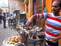 'Spoilt by choice'...a baked or fried version (Rajib Singha) Tags: street travel portrait people food india interestingness market westbengal hooghly flickriver sheoraphuli canonpowershots90