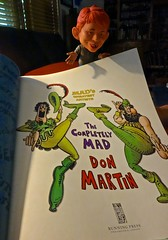 Alfred Helps Me Turn the Pages (ricko) Tags: book alfredeneuman bobblehead madmagazine donmartin cartoonist reading werehere 265366 2016