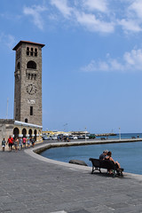 Mandraki Port (lGBSl) Tags: colossus mand church bench port city clock deer rhodes sea statue pillar evaggelismos ekklisia ocean seven greek tower couple island chapel boat column wonders harbour greece