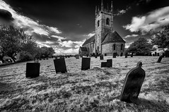 In the churchyard (David Feuerhelm) Tags: blackandwhite monochrome nikkor building church tower bw contrast infrared graves grass sky perspective history historic lincolnshire sempringham nikon d90 wideangle churchyard nikonflickrtrophy atmosphere trees low sigma1020mm silverefex