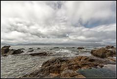 Camino de rocas en el mar (Fernando Fornis Gracia) Tags: espaa galicia corua acorua lacorua portodoson mar nubes rocas paisaje naturaleza landscape