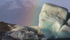 Rainbow and the face in the Ice (Nick L) Tags: iceland ice icelagoonatjokulsarlon icelagoonatjökulsárlón rainbow mountains landscape jökulsárlón jokulsarlon islande