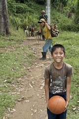 the path of progress (Pejasar) Tags: boy boys basketball play dog work loadofcutwood goats path progress dailylife candid children guatemala eltesoro