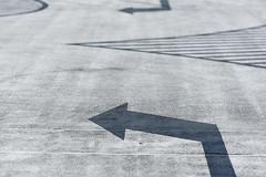 Two arrows (Jan van der Wolf) Tags: map152195vv arrow parking parkeerplaats arrows grey lijnen scherptediepte depthoffield lines pijl pijlen