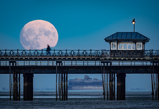 Supermoon rising over Ryde pier on the Isle of Wight.