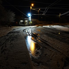Lighted snowy tracks (mkorolkov) Tags: street streetphotography night streetlights snow puddle reflection fujifilm xe1 xf1855mm xf1855mmf284