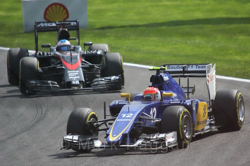 Felipe Nasr leads Fernando Alonso in the 2015 Belgium Grand Prix