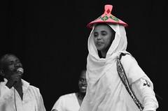 A little pink hat on the dancer (Mister.Marken) Tags: pink hat dancer selectivecolor ethiopian pinkhat