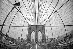 Brooklyn Bridge: Asymmetrical (Studio Fuentes) Tags: city nyc bridge sky urban newyork brooklyn clouds nikon cloudy gothic arches landmark fisheye brooklynbridge 105mm d90
