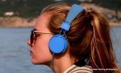 05-IMG_1973 Candid (marinbiker 1961) Tags: isladeformentera 2015 spain girl redhair music sunglasses hills sea blue headphones outdoor people