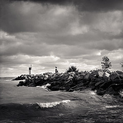 Harbour (Joe Iannandrea) Tags: blackandwhite lighthouse seascape weather landscape pier waves wind harbour stormy ilfordhp5 lakeontario isf breakwall filmphotography bronicas2a pmkpyro jordanstation lincolnontario 150mmf35zenzanon