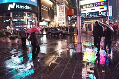 Out in the Rain 2 (Lojones13) Tags: city urban newyork colors rain umbrella timessquare bluehour