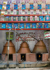 rose water distillery, Isfahan Province, Kashan, Iran (Eric Lafforgue) Tags: travel water rose vertical shop retail outdoors store bottle iran bottles display text middleeast selection nobody nopeople row copper merchandise variety script brass trade distillery kashan distillation shopinterior persiangulfstates fingarden alembic 16718 إيران иран colourimage イラン irão isfahanprovince arabicalphabet 伊朗 westernasia 이란 rowsofbottles rosewatershop