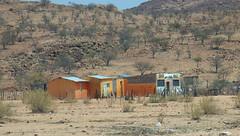 Namibia's Beauty:  22.  The Mall, near the Ugab River, Damaraland (ronmcbride66) Tags: namibia namibiasbeauty ugab ugabriver mall ugabmall damaraland drought sesert solarpanel shopping shoppingmall granite rendering mural