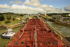 Panama Canal - Transit (Zahid - At Sea - Thanks for the favs and comments) Tags: panama outdoor canal house boat ships grass highland pipes locomotives sky cloud landscape bridge water aqua hillside waterside road archietecture infrastructure building structure architecture people watchtower attractions tourism tourists tug locomotive power metal ship tanker vessel red plant tres land waterscape landscapes skyline heights waterheights differentwaterlevels lockgate lock