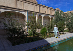 A mullah in boroujerdi historical house, Isfahan province, Kashan, Iran (Eric Lafforgue) Tags: 1people adult adultsonly arcade arch architecture basin boroujerdi borujerdi building builtstructure colorimage courtyard day destination elegance garden historic historicalhouse historicalresidence history horizontal house iran iranianculture islamicarchitecture kachan kashan landmark middleeast mullah onemanonly oneperson ornament ornamentation palace persia photography pond prestigious sight travel traveldestinations tree isfahanprovince ir