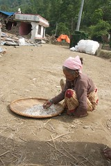 it aint easy living through an earthquake (diminoc) Tags: nepal sindhupalchowk earthquake quake tremor destroyed damaged buildings collection poverty rice basket old elderly woman