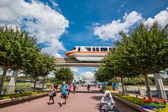 Monorail Crossing (Scottwdw) Tags: orlando futureworld nikon people waltdisneyworld vacation orange florida guests trees blue travel epcot sky 1635mmf4vr d750 monorail clouds spaceshipearth unitedstatesofamerica 840 motion blur