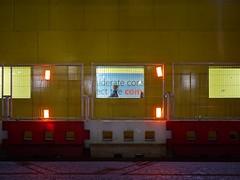 The night walker (Stephen Toye) Tags: night nightfall nightscene fluorescentlight london street bishopgate leica summilux1425mm lumix gx7 shadows cityscene geometry alone walking