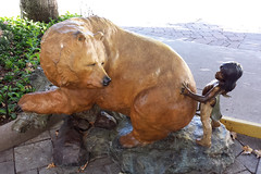 Oops (Explored, thank you!) (twm1340) Tags: bear statue art artwork tlaquepaque shopping center sedona az arizona indian boy arrow bow accident explore explore124