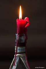 warm, beautiful...a candle during the cold season (greg luengen) Tags: candle kerze licht light winter fall cold kalt fire feuer wine bottle still stillleben closeup macro makro sony sonyalpha nex