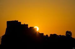 Bonjour (Lorenoir) Tags: sky orange sun castle sunshine silhouette yellow sunrise campania pentax castello castelloaragonese pentaxiani pentaxk50 sunriseatmosphere