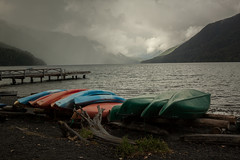 stormy weather (~ yucatan ~) Tags: lake water clouds pier washington canoe driftwood crescentlake olympicstatepark