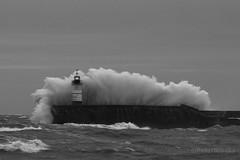 Impact! - Newhaven Lighthouse (PeterBrooksPhotography) Tags: uk winter sea blackandwhite lighthouse storm beach season landscape sussex nikon harbour wave newhaven peterbrooksphotography ©peterbrooks
