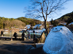 Unexpected welcome (david.ow) Tags: huts spring olympus hill nature snowman takayama traditional em5ii hida vilage lake totoro japan snow