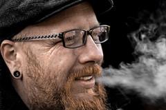 Maik (Paul Bemert) Tags: people portrait smoke availablelight menschen mann man rauchen brille glasses piercing ohrring smiling lcheln