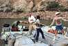 35-414 (ndpa / s. lundeen, archivist) Tags: nick dewolf nickdewolf color photographbynickdewolf 1970s 1973 1972 film 35mm 35 reel35 arizona northernarizona southwesternunitedstates canyon marblecanyon grandcanyon coloradoriver raftingtrip raftingexpedition rafting river riverrafting raft inflatable people lifejackets lifepreservers floatationdevices children kids watersedge riversedge riverbank camp unload unloading load loading cot cots boy boys men man sanderson sandersonraftingexpeditions sandersonriverexpeditions srig