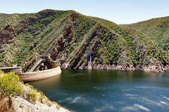The low water level of the Kouga Dam (markdescande) Tags: africa spring arch kouka nature water loerie lake background structure dam activities irrigation reserve scenic sky loeriedamnaturereserve concrete view low hydro side landscape sunny tourism aquaculture level reservoir tunnel outdoor patensie naturereserve natural beautiful scene industrial kouga river scenery construction travel created baviaanskloof blue consumption green engineering human kougariver mountain