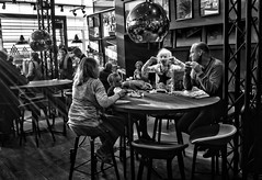 Wish Upon A Star (Explored November 13, 2016) (Anne Worner) Tags: anneworner blackandwhite family father mother son bw beverage cafe candid chairs children daughter eating globe light mframed necklace partitions people photos rays reflection sidelight sitting start street streetphotography sunrays table walls windows kastrup copenhagen denmark airport