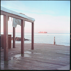 (Paranoia, Part II) (Robbie McIntosh) Tags: rolleiflex rolleiflex28e rolleiflex28e2 rolleiflexplanar28e carlzeissplanar80mmf28 tlr 120 mediumformat 6x6 square negative film filmisnotdead moyenformat mittelformat medioformato pellicola selfdevelopment dyi homedevelopment kodak kodakektar100 ektar newtopographics newtopography c41 color bellinifoto bellinic41 bellini decay landscape beach portici poles ship fences