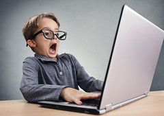 Shocked and surprised boy on the internet with laptop computer concept for amazement, astonishment, (Lady Masta) Tags: afraid amazed amazement astonished astonishment astounded back bad boy business child childhood colour computer curiosity development disbelief education emotion excited expression failure fear frightened horror innocence internet laptop looking media mischief mistake mouth news open pc people pornographic problems realisation scared school scream shocked social speechless stress stunned surprise technology trouble typing worried
